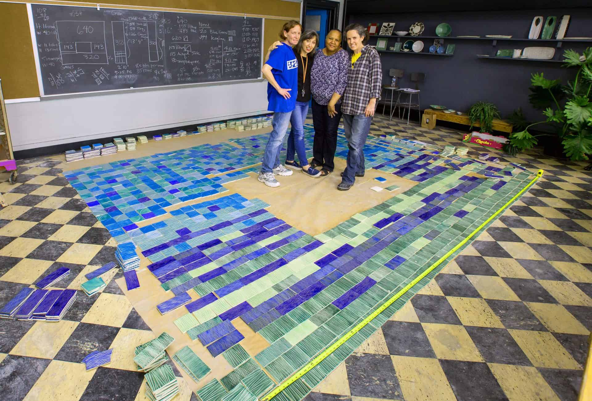 Mudgirls team in studio with fireplace surround tiles