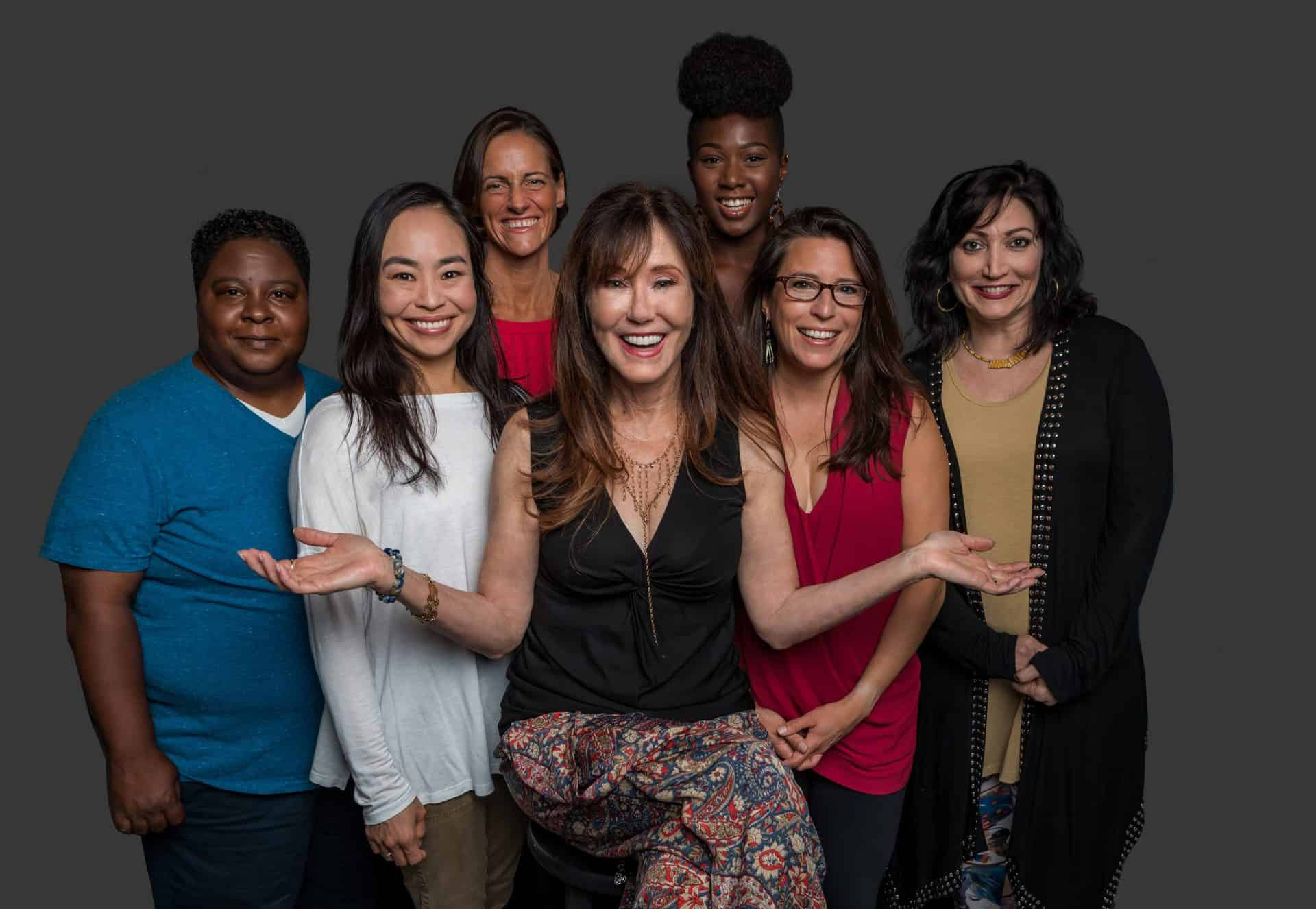 Mary McDonnell (center) and the company of Gloria - A Life. Photo by S. Bola Okoya.