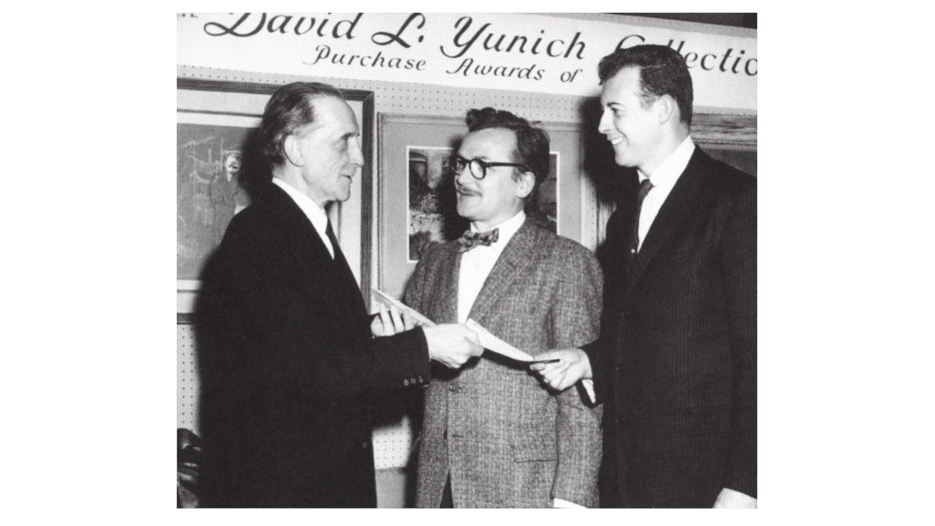 Marcel Duchamp presents Adolph Conrad (center) and W. Carl Burger (right) an award, 1960